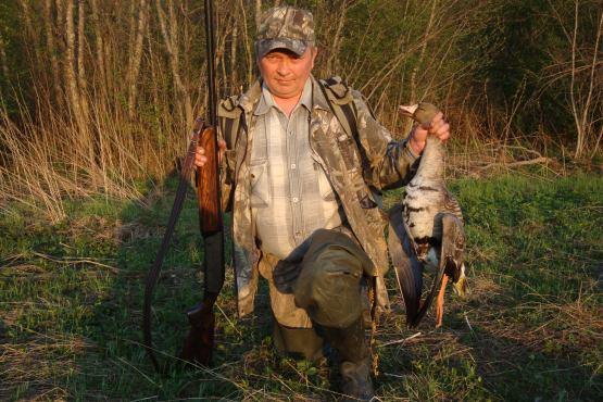 мужчина охотник и мужчина рыбак